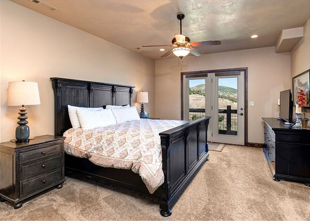 Mid-level King master bedroom with en suite bathroom with separate soaking tub and shower
