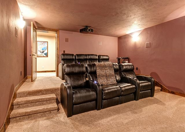 Mid-level theater room with large screen, projector and XBOX