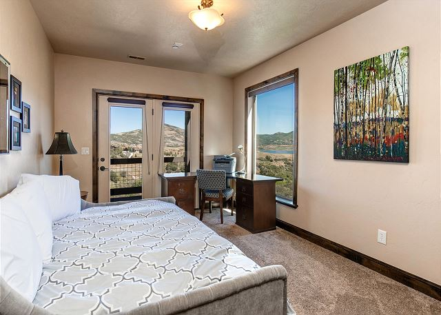 Mid-level bedroom with full bed, desk and lake views!