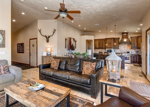 Main level living room with gas fireplace and TV