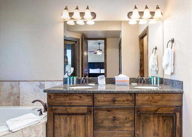 Mid-level master en suite bathroom with separate soaking tub and shower