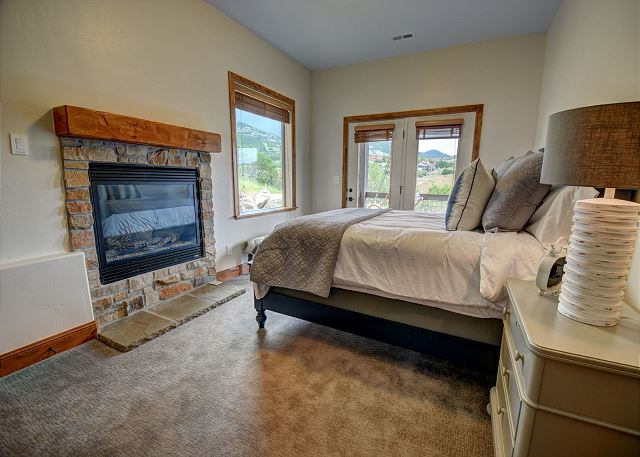 Queen Bedroom with Fire Place and Patio Access