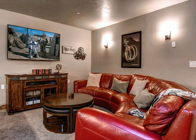 Basement Game Room - Large HD TV, seating, full-sized pool table, Playstation, board games, cards, bar with win fridge