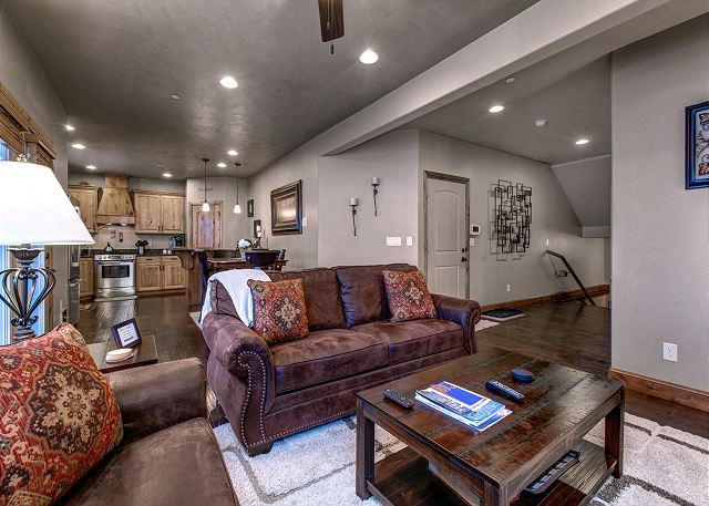 The main level has a grand great room with a gas fireplace, large HD TV, and plenty of seating.
