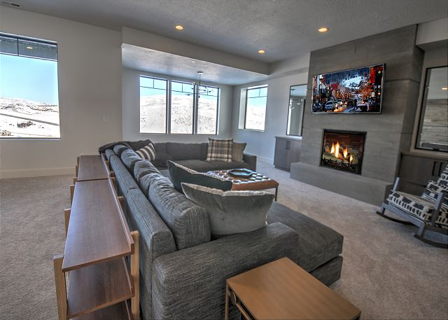 Lower Level Main Room with Sectional Sofa, TV, Fireplace and Air Hockey Table