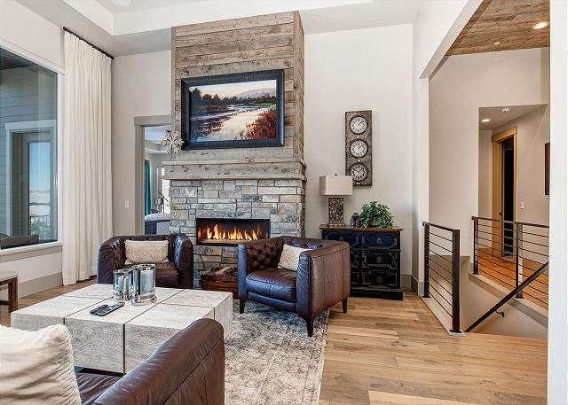 Main Living Room with Gas Fire Place and TV Behind the Picture Above the Fire Place