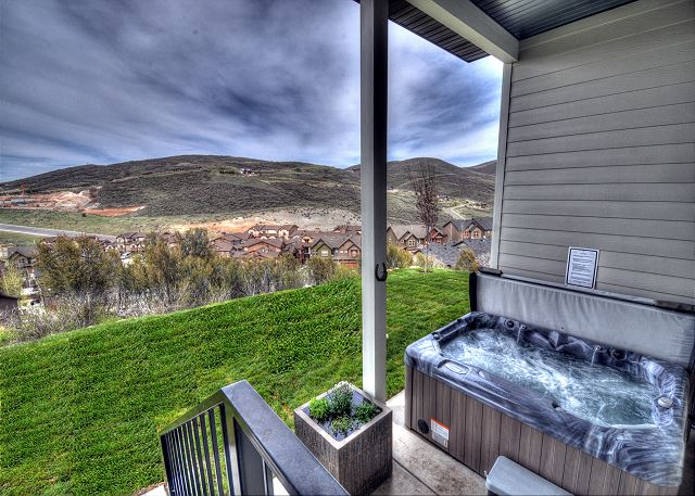 Patio with a private outdoor hot tub perfect for relaxation after a day at the mountain