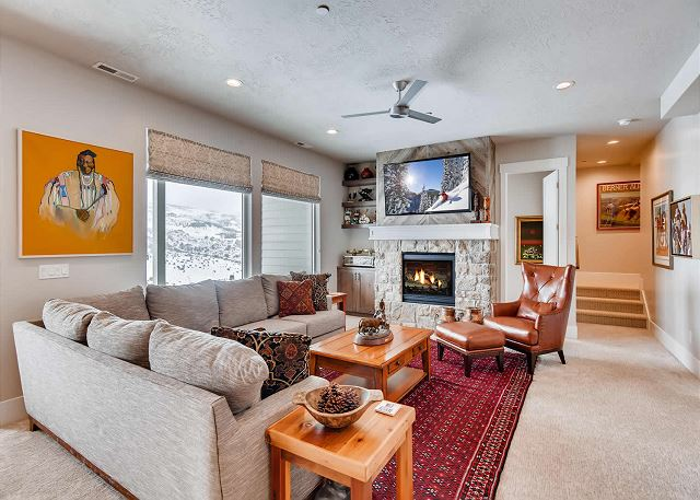 Lower Level Family Room with Gas Fireplace, Large TV, Comfortable Seating/Gathering and an Air Hockey Table!