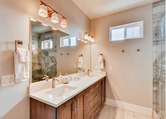 Main Level Master En Suite Bathroom with Separate Soaking Tub and Shower