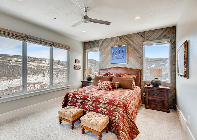 Main Level Master Bedroom with King Bed, En Suite Bathroom with Separate Soaking Tub and Shower PLUS a Large TV and Walk-out to Balcony with Seating and Views!