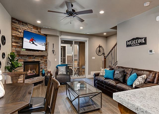 Main Living Room with Gas Fireplace, Large Smart TV and Queen Sleeper Sofa