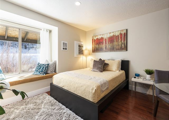 Spacious Studio with Queen Bed, Window Seating, Full Kitchen, Full Bathroom, and TV.