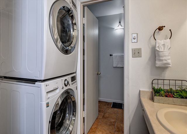 Full Bathroom with Tub/Shower Combo Washer/Dryer (Note: washer and dryer pictured has been replaced with a washer/dryer combo)