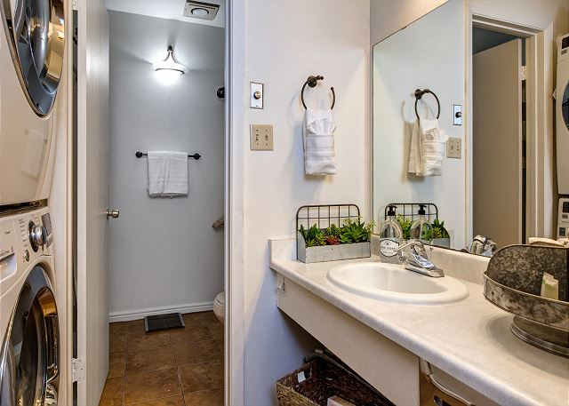Full Bathroom with Tub/Shower Combo and Washer/Dryer. (Note: washer and dryer pictured has been replaced with a washer/dryer combo)
