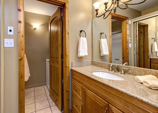 Bathroom with Tub/Shower Combo and Full Size Washer/Dryer