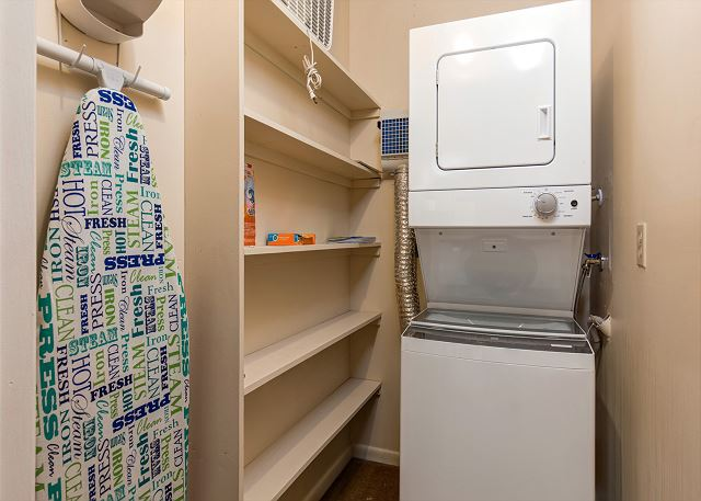 Laundry Room with Full Size Stacked NEW Washer and Dryer