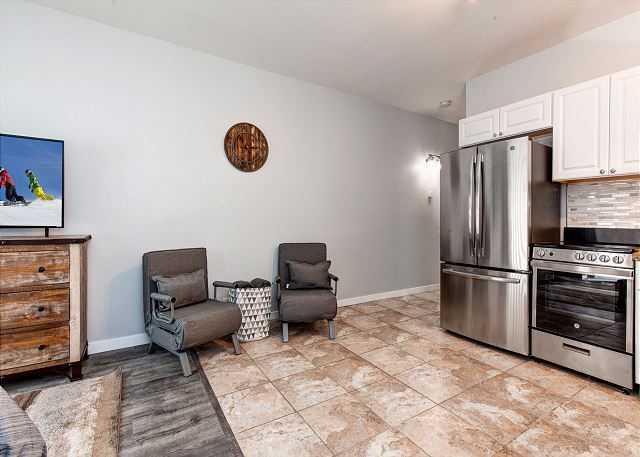 Spacious Studio with Queen Bed, Two Twin Sleeper Chairs, TV, Full Kitchen and Patio