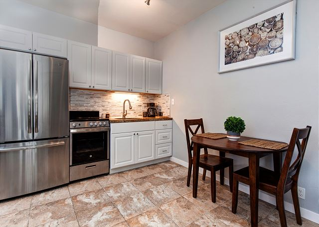 Spacious Studio with Queen Bed, Two Twin Sleeper Chairs, TV, Full Kitchen/Dining and Patio