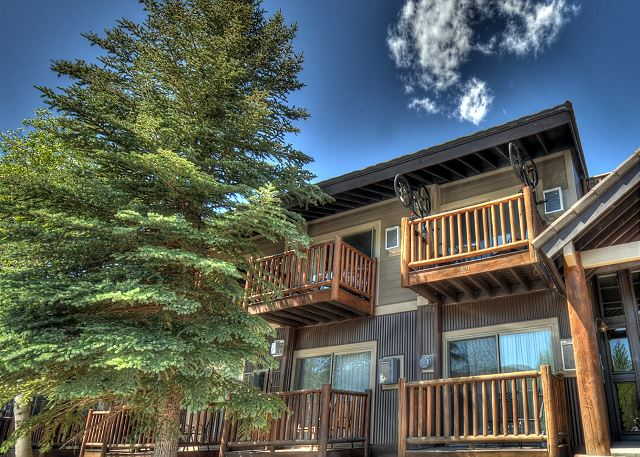 Building 8 - Condo balcony is top left with the two hanging mountain bikes for guest use.