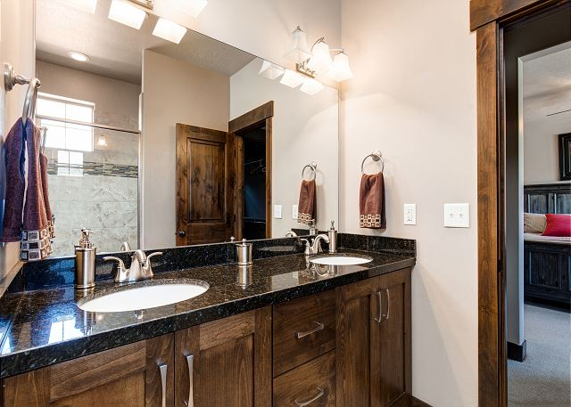 En suite main level master bathroom with dual head shower