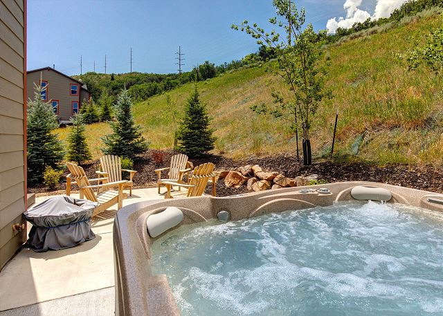 Private rear patio with BBQ, Fire Pit, Adirondack Chairs and Large Hot Tub!