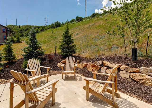 Private Patio and Comfortable Adirondack Chairs with Fire Pit for visiting and enjoying the outdoors!