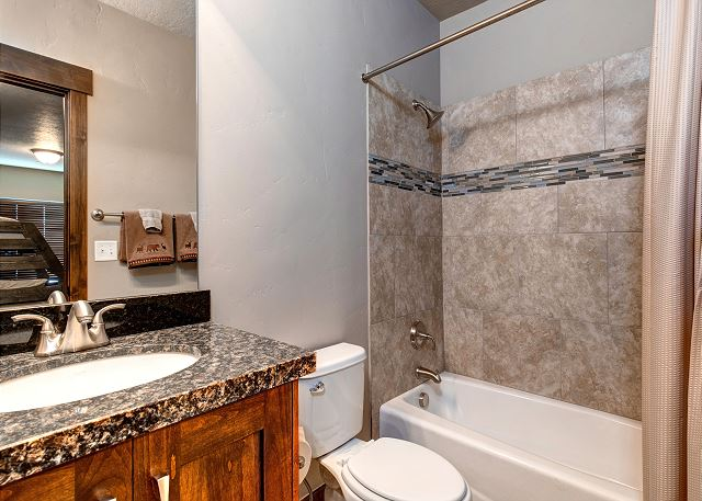 full bathroom with tub/shower combination