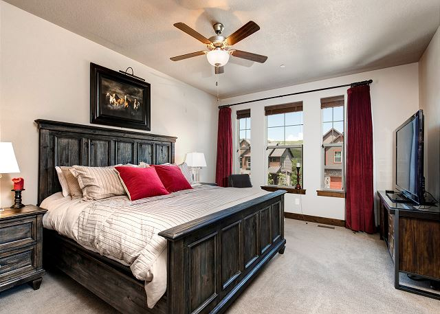 Main level master bedroom with king bed and en suite bathroom
