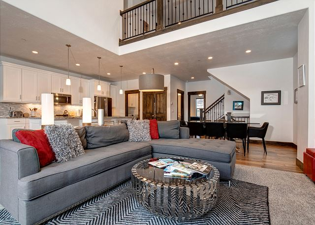 Main Living Room with Gas Fireplace, Large Sectional Sofa and TV