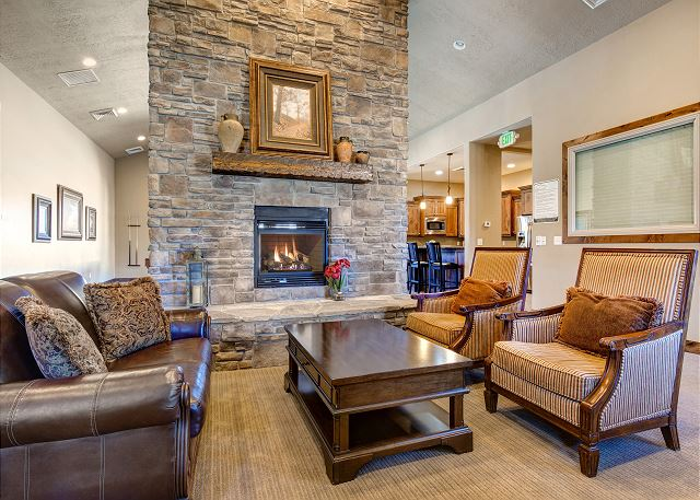 Clubhouse Main Room with Comfortable Seating, Fireplace, Pool Table, Kitchen and More!