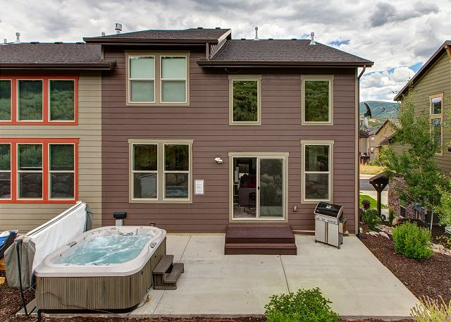 Rear of home with BBQ and Private hot tub