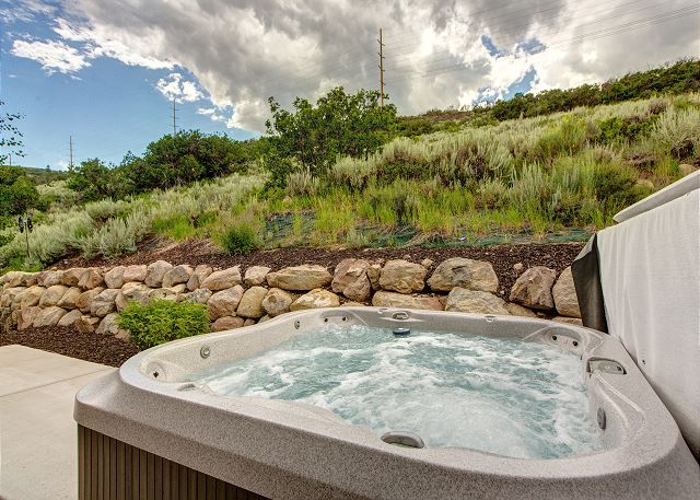 Private hot tub backs to mountainside for beauty and privacy
