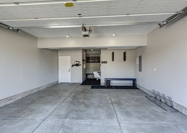 Two car garage with bench and ski racks