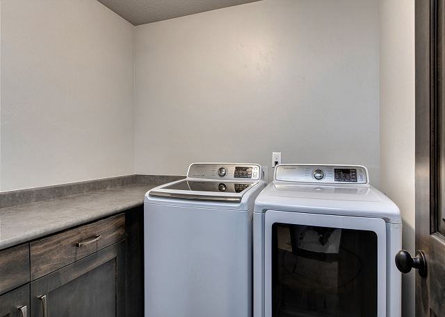 Laundry room with HE full size washer and dryer