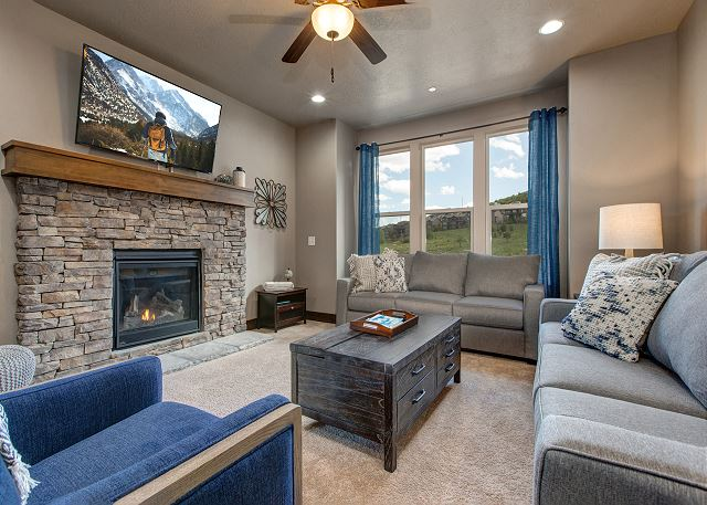 Living room with plenty of seating, large TV, Queen sleeper sofa and gas fireplace