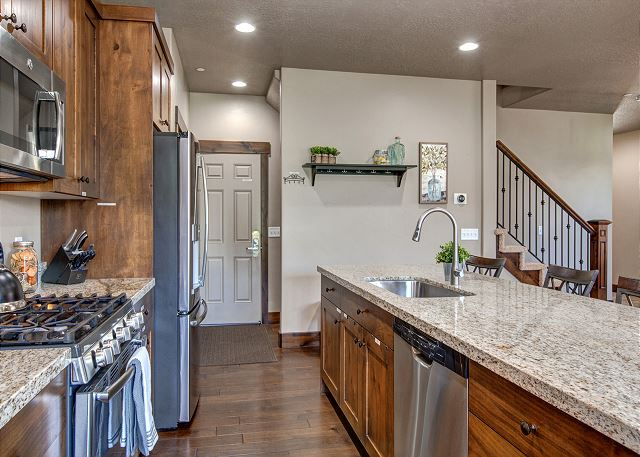 Fully equipped kitchen with bar seating and breakfast table