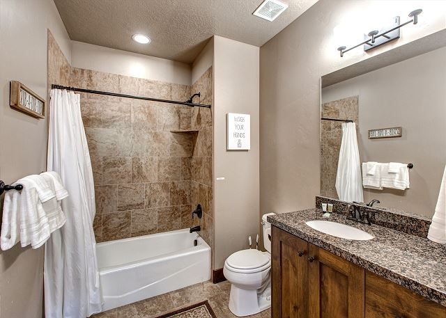 Downstairs shared bathroom with tub/shower combo