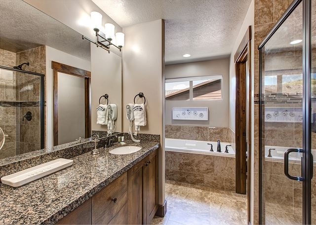 Upstairs Master Bathroom with separate tub and shower + huge walk-in closet