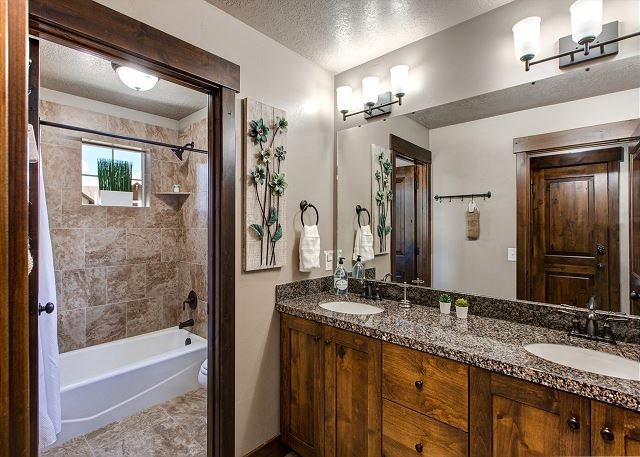 Upstairs Shared Bathroom with Tub/Shower combo and dual sinks