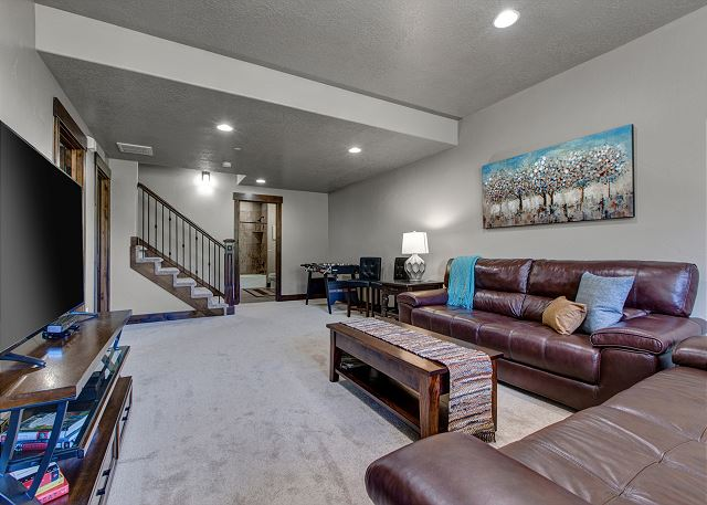 Downstairs main room with comfortable seating, large TV, XBOX gaming system and Foosball table