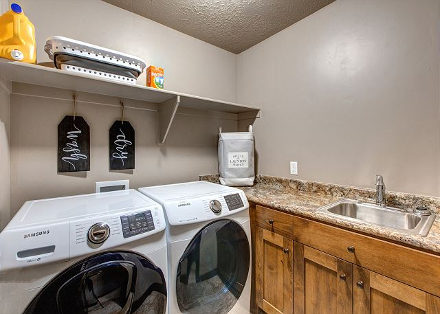 Upstairs laundry room with HE washer and dryer