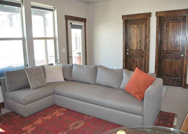 Lower Level Bedroom/Den with Sectional Sleeper, Table and TV