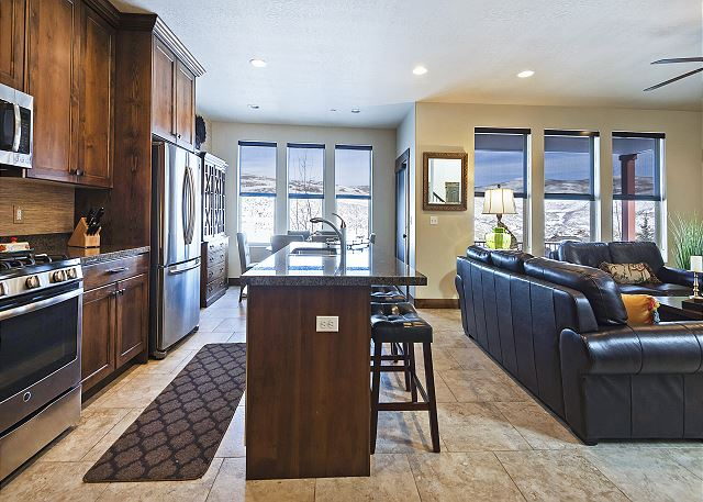 Spacious Living/Kitchen/Dining Area with Comfortable Seating, Gas Fireplace and TV