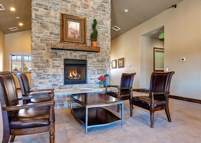 Clubhouse Common Area with Comfortable Seating and Large Stone Gas Fireplace