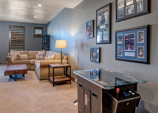 Lower Level Family Room with Sectional Sofa, Smart TV with Dish Satellite and a Fun Pacman Gaming Table