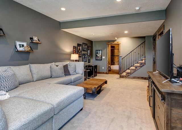 Lower Level Family Room with Sectional Sofa, Smart TV with Dish