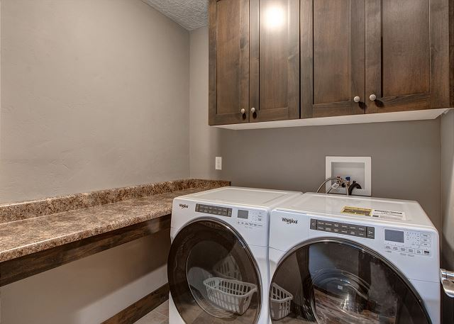 Laundry Room with Full Size HE Washer and Dryer