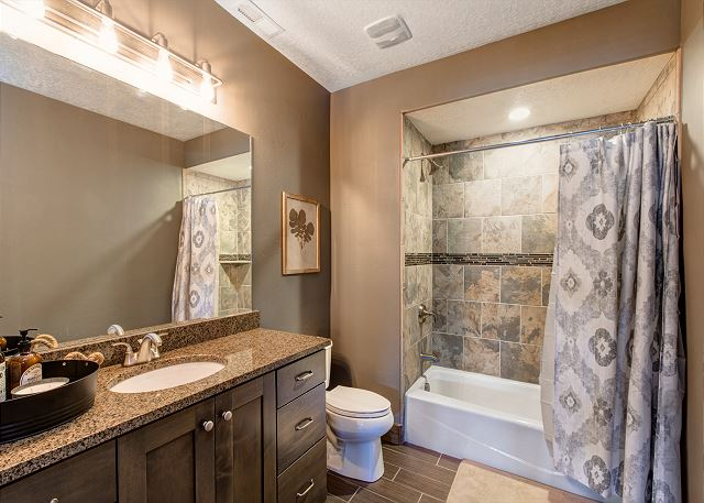 Lower Level Shared Full Bathroom with Tub/Shower Combo