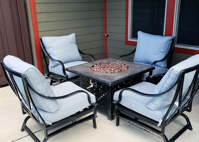 Comfortable seating for 4 with a fire pit table for ambiance and warmth on cool mountain evenings