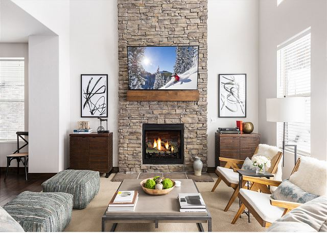 """Main Level Living Room with Comfortable Seating, 65"""" Smart TV with DIRECTV, Gas Fireplace and Large Windows for Light and Views"""